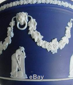 Wedgwood cobalt jasperware jardiniere with floral and lion accents